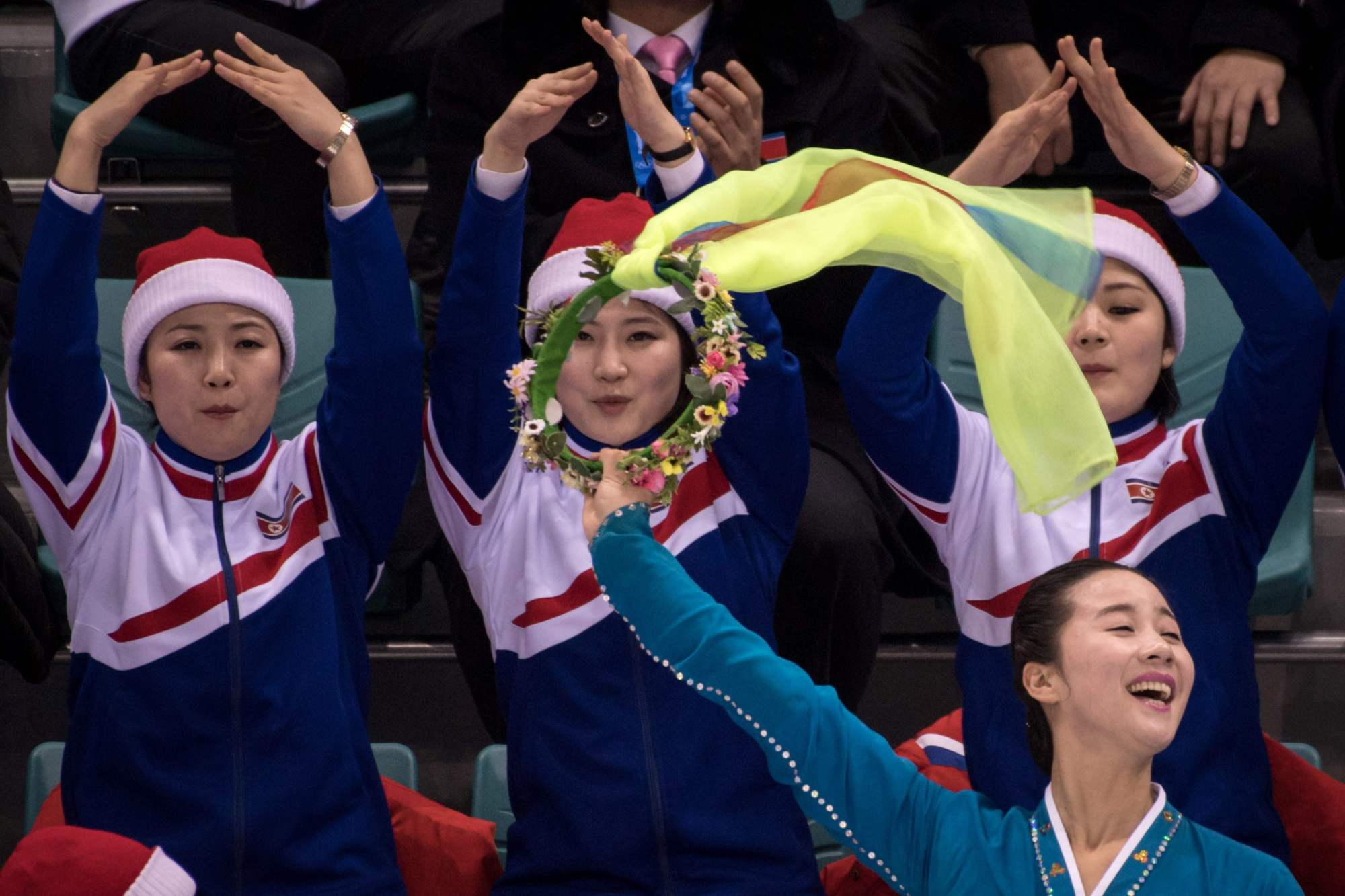 North Korean cheerleaders attend the hockey match between Sweden and the unified Korean women's Olympic team on Monday in Gangneung, South Korea.   AFP-JIJI