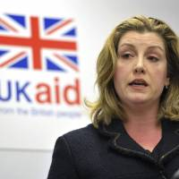 British International Development Secretary Penny Mordaunt is seen in November. Oxfam's deputy chief executive Monday resigned amid the scandal involving sex abuse in Haiti after the 2010 earthquake. Penny Lawrence says she's ashamed of what happened on her watch. Mordaunt is demanding that Oxfam show moral accountability and provide full disclosure about the case. | NICK ANSELL / PA FILE / AP