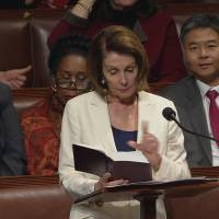 U.S. House Minority Leader Nancy Pelosi (D-CA) is shown reading from the Bible during a marathon speech on the floor of the House of Representatives in this still grab taken from video on Capitol Hill in Washington Wednesday. | U.S. HOUSE TV / HANDOUT / VIA REUTERS