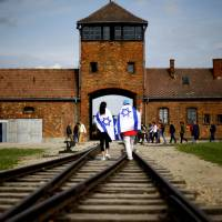How past wounds fuel debate over Polish law on Holocaust experience