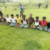 Gravediggers say Myanmar forces and Buddhist villagers executed Rohingya after torching their homes