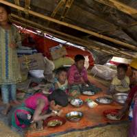 A newly arrived Rohingya family eats at the Balukhali refugee camp near Cox's Bazar, Bangladesh, Jan. 13. Rohingya Muslims, who have been loathed by Myanmar's Buddhist majority for decades, are locked down in their villages — sometimes even in their homes — and prevented from farming, fishing, foraging, trade and work. The Myanmar government denies ethnic cleansing and says it is battling terrorists. | AP