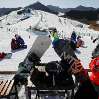China's winter resorts face tougher terrain despite Olympics excitement