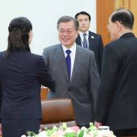 South Korean President Moon Jae-in greets Kim Yo Jong (left), North Korean leader Kim Jong Un's younger sister, and Kim Yong Nam, North Korea's ceremonial head of state, during their meeting at the presidential Blue House in Seoul on Saturday. | AFP-JIJI