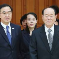 Kim Yo Jong, the younger sister of North Korean leader Kim Jong Un, and North Korea's ceremonial head of state, Kim Yong Nam (right), are escorted into a meeting room by South Korean Unification Minister Cho Myoung-gyon before talks with South Korean President Moon Jae-in at the presidential Blue House in Seoul on Saturday. | AFP-JIJI