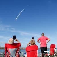 Spectators at Cocoa Beach watch SpaceX's first Falcon Heavy rocket launch from the Kennedy Space Center, Florida, Tuesday. | REUTERS