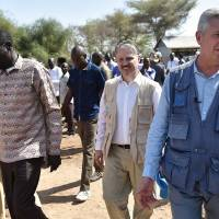 United Nations High Commissioner for Refugees (UNHCR) Filippo Grandi (right) and Turkana county Gov. Josphat Nanok (left) walk during a visit with recently arrived refugees from South Sudan on Thursday at the Kakuma refugee complex. Filippo Grandi, and the Emergency Relief Coordinator, Mark Lowcock, launched a funding appeal to support refugees fleeing the worsening humanitarian situation in South Sudan as well as multitudes of the internally displaced now facing desperate conditions in the conflict now in its fifth year. | AFP-JIJI