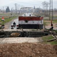 A checkpoint held by Syrian forces loyal to President Bashar Assad is pictured in Aleppo, Syria, Saturday. | REUTERS