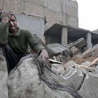 Syria regime airstrikes pound last rebel strongholds and hospitals, allegedly choke civilians with gas