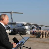 Russian President Vladimir Putin addresses the troops at the Hemeimeem air base in Syria in December. Several private Russian military contractors were killed by a U.S. strike in Syria, Russian media reported Tuesday in a development that could further inflame Russia-U.S. tensions if officially confirmed. | MIKHAIL KLIMENTYEV / POOL PHOTO / VIA AP