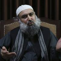 Agha Jan Motasim, a former senior member of the Taliban leadership shura or council, speaks during an interview with AP in Kabul Feb. 7. Mohtism, who still counts the radical religious movement's leader, Mullah Habaitullah Akhunzada, among his friends, warned that Donald Trump's strategy of using the military to force a more compliant Taliban to the negotiation table could lead to more suicide attacks by the Taliban, seeking revenge for U.S. and Afghan government assaults in rural Afghanistan, where they often hold sway. | AP