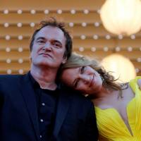 Director Quentin Tarantino and actress Uma Thurman pose on the red carpet as they arrive for the screening of the film 'Sils Maria' ('Clouds of Sils Maria') in competition at the 67th Cannes Film Festival in Cannes, France, in 2014.   REUTERS