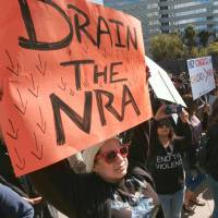 A woman takes part in an anti-gun rally in downtown Los Angeles on Monday. | AP