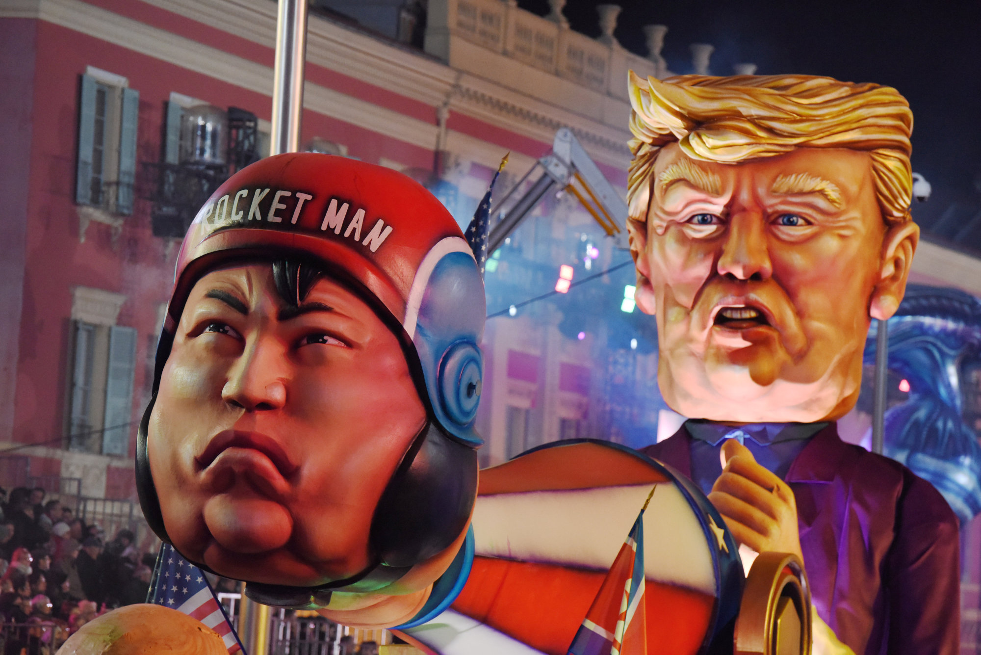 A float with effigies of North Korean leader Kim Jong Un and U.S. President Donald Trump is paraded through the crowd during the 134th Carnival parade in Nice, France, on Tuesday.   REUTERS
