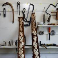 Horsehide skis made by Slanbek stand next to his tools. | REUTERS