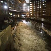 Seawater floods the entrance to the Brooklyn Battery Tunnel in New York in the wake of Superstorm Sandy in 2012. New satellite research shows that global warming is making seas rise at an ever increasing rate. Scientists say melting ice sheets in Greenland and Antarctica is speeding up sea level rise so that by 2100 on average oceans will be 2 feet higher than today, probably even more. | AP