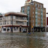 The intersection of 8th Street and Atlantic Avenue is flooded in Ocean City, New Jersey, after the storm surge from Superstorm Sandy flooded much of the town in 2012. | AP