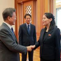 South Korea's President Moon Jae-in welcomes North Korean leader Kim Jong Un's sister Kim Yo Jong and North Korea's ceremonial head of state Kim Yong Nam on Feb. 10. | AFP-JIJI