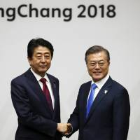 Abe and Moon show unity as Winter Games open
