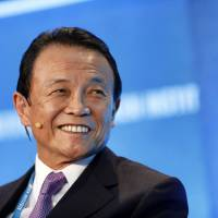 Aso becomes Japan's longest-serving finance minister since the war
