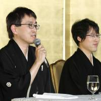 Shogi champion Yoshiharu Habu (left) and go master Yuta Iyama face reporters Tuesday after they were given the People's Honor Award. | KYODO