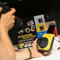 Instant cameras growing popular with Japanese photo-sharing fans hungry for 'instagenic' shots