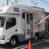An RV modified to operate as a mobile pharmacy is seen in Tsu, Mie Prefecture, loaded with medicine and pharmacy equipment. | CHUNICHI SHIMBUN