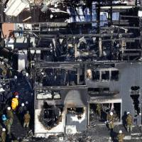 A two-story home in Kanzaki, Saga Prefecture, is seen on Tuesday morning after a Ground Self-Defense Force chopper crashed into it on Monday afternoon. | KYODO