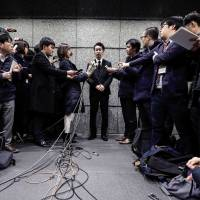 Yusuke Otsuka, chief operating officer and co-founder of cryptocurrency exchange Coincheck Inc., faces the media at its headquarters in Tokyo last week. Clients pulled ¥40.1 billion from the exchange on Tuesday, the first day they were allowed to make withdrawals since it was hit by a cybertheft last month. | BLOOMBERG