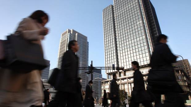 Politicians spar over Japan's overtime system after health ministry accused of bending data