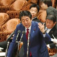 Prime Minister Shinzo Abe speaks during a session of the Lower House Budget Committee on Tuesday. Debate is raging over the government's handling of labor data.   KYODO