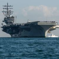 The USS Ronald Reagan arrives at Yokosuka Naval Base in December after a scheduled patrol. | NAVY MEDIA CONTENT SERVICES