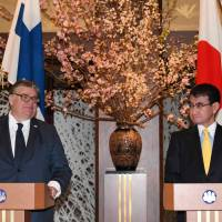 Finnish Foreign Minister Timo Soini (left) delivers remarks beside Japanese Foreign Minister Taro Kono prior to their dinner meeting at the Foreign Ministry's Iikura guesthouse in Tokyo on Wednesday. | AFP-JIJI