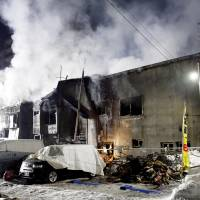 Smoke billows from the Soshiaru Haimu residential facility for people on welfare in Sapporo early Thursday morning. | KYODO