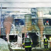 An apartment building in Sapporo that was destroyed in a fire, killing 11 mainly elderly residents who lived on welfare, is seen on Thursday. | KYODO