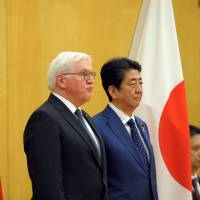 German President Frank-Walter Steinmeier (left) reviews the guard of honor with Prime Minister Shinzo Abe during a welcoming ceremony at the Prime Minister's Office in Tokyo on Tuesday. | REUTERS