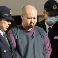 Kotaku Hasegawa leaves a police station in Sapporo on Monday to be sent to prosecutors on suspicion of abandoning the body of a woman. Two other men have been arrested on the same charge. | KYODO