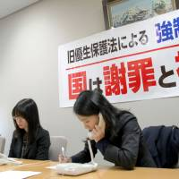 A lawyer at the Sendai Bar Association office on Friday takes notes while talking to people affected by the now-defunct Eugenic Protection Law. | KYODO