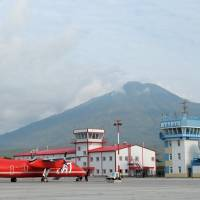 A civilian plane stands at Iturup Airport on the island of Etorofu in the disputed Northern Territories, in this 2014 file image. This week the airport was given a dual civil-military status, clearing the way for the Russian Air Force to set up a base at the site. | PRESS SERVICE OF THE PRESIDENT OF RUSSIA / KREMLIN.RU