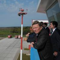 Sergei Ivanov, chief of staff to Russian President Vladimir Putin, views Iturup Airport on Etorofu in the disputed Northern Territories, during a 2014 visit. This week the airport was given a dual civil-military status, clearing the way for the Russian Air Force to set up a base at the site. | PRESS SERVICE OF THE PRESIDENT OF RUSSIA / KREMLIN.RU