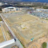 Construction work continues at J-Village, a national soccer training center that was used by workers dealing with the 2011 Fukushima nuclear crisis, in this photo taken in March last year. The facility is set to be partially reopened in July.   Kyodo