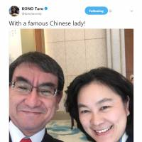 Foreign Minister Taro Kono's selfie with China spokeswoman draws mixed reactions