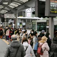 Long lines form as people wait to ride buses at JR Kyoto Station on Feb. 11. | KYODO