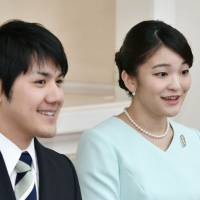 Princess Mako and her fiance, Kei Komuro, are seen in this photo taken on Sept. 3. | POOL / VIA KYODO