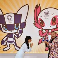 Ryo Taniguchi, the designer of the characters that will serve as mascots for the Tokyo 2020 Olympic Games and Paralympics Games, is seen after it was announced his design was selected in Tokyo on Wednesday. | YOSHIAKI MIURA