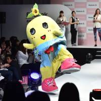A 'pear fairy' named Funassyi, the unofficial mascot of the city of Funabashi, Chiba Prefecture, performs at a promotional event in April 2015. | AFP-JIJI