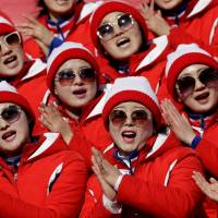 North Korean cheerleaders perform during the first run of the women's slalom at the 2018 Winter Olympics in Pyeongchang, South Korea, on Friday.   AP
