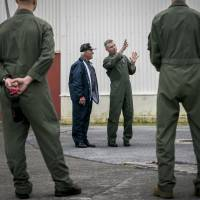 Lt. Col. Bryan G. Swenson (second from right) gives U.S. Navy World War II veteran Don Irwin (second from left) an explanation about the MV-22 Osprey in April at Marine Corps Air Station Futenma in Ginowan, Okinawa. | III MARINE EXPEDITIONARY FORCE