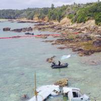 The wreckage of an MV-22 Osprey that ditched off Nago, Okinawa Prefecture, in December 2016 is shown in this photo taken by a drone. | KYODO