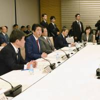 Members of the Council on Economic and Fiscal Policy attend a meeting at the Prime Minister's Office on Tuesday. | KYODO